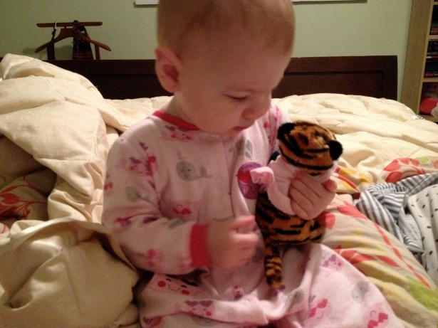 Pearl and her tiger, Stripes, who was given to her in celebration of a healthy heart