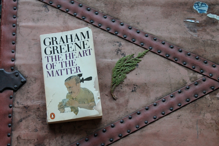 The Heart of the Matter - Graham Greene (Penguin Books, 1981) (Guess who took those tiny bites out of the cover of my book?)